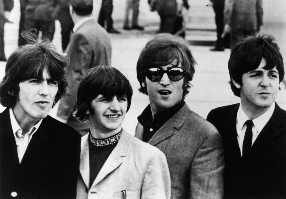 BEATLES PICTURED IN PHOTO RELEASED BY CAPITOL RECORDS